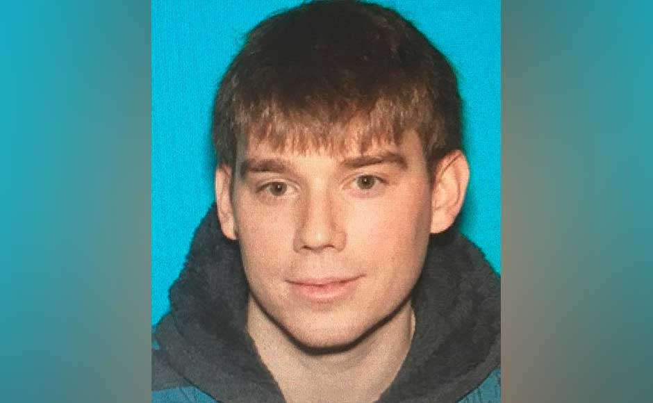 Police identified the suspect as 29-year-old Travis Reinking and said he could be armed with a rifle and a handgun, after firing an AR-15 semi-automatic rifle at the restaurant, where he was nude except for a green jacket. A military-style weapon, the AR-15 has been regularly used in US mass shootings. AP