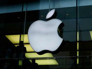 An Apple logo is seen on the building's facade. Image: Reuters
