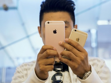 A customer tries out an iPhone 6s Plus and an iPhone 6s at an Apple Store. Reuters