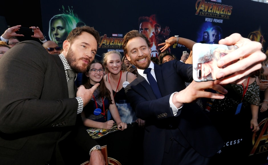 Chris Pratt and Tom Hiddleston pose with fans.Reuters