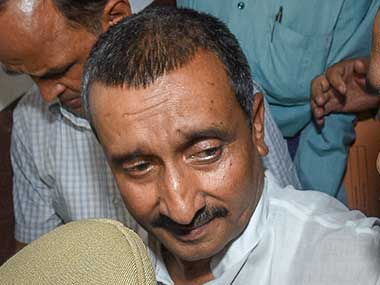 Rape accused MLA Kuldeep Singh Sengar being taken away from the CBI court in Lucknow. PTI