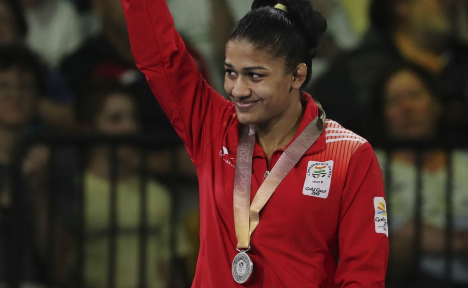 India's Silver medalist in women's FS 53Kg wrestling Babita Kumari waves during a medal ceremony at the Commonwealth Games. AP