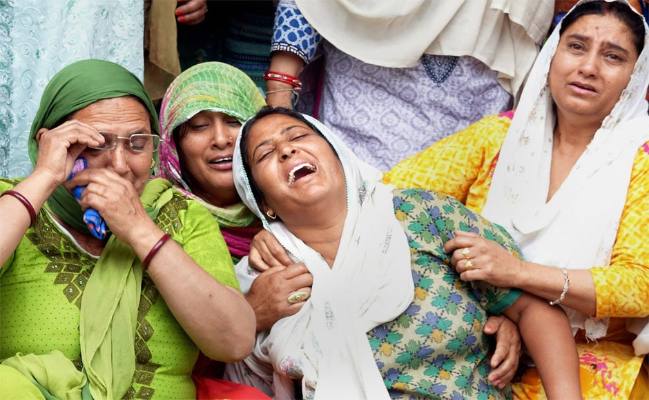 Family members mourn the death of the school children on Tuesday. Around 45 students of Wazir Ram Singh Pathania Memorial Public School were returning home when the bus fell into a 100-feet deep gorge near Gurchal village on the Nurpur-Chamba road. PTI