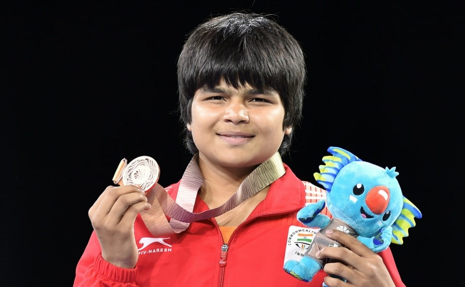 Bronze medal winner India's Divya Kakran at the medal ceremony of the women's freestyle 68 kg wrestling event. This was Divya's debut at CWG. PTI