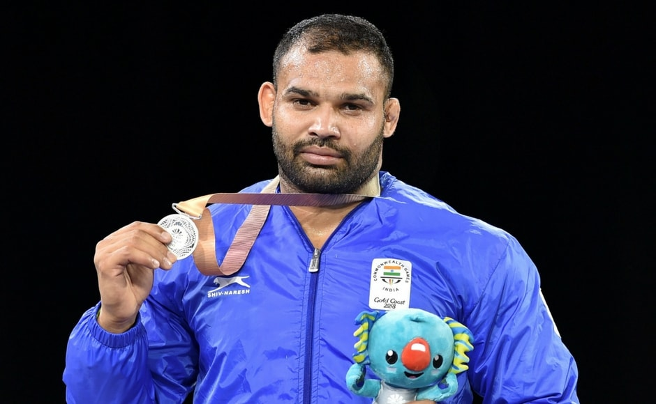 Silver medal winner India's Mausam Khatri at the medal ceremony of the men's freestyle 97 kg wrestling event. Mausam lost to Martin Erasmus of outh AFrica in the final PTI