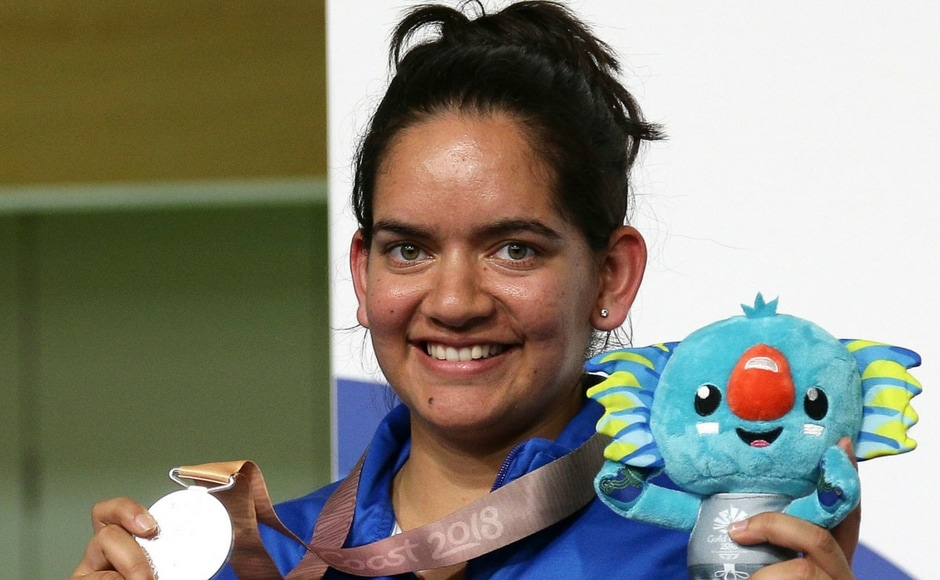 Anjum Moudgil of India poses with her silver medal during the women's 50m Rifle 3P final at the Belmont Shooting Centre. AP