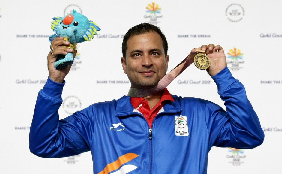 Sanjeev Rajput of India celebrates winning the gold medal at the men's 50m Rifle 3P final at the Belmont Shooting Centre during the 2018 Commonwealth Games. PTI