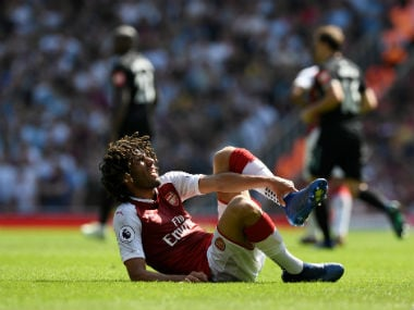 Arsenal's Mohamed Elneny reacts after sustaining an injury. Reuters