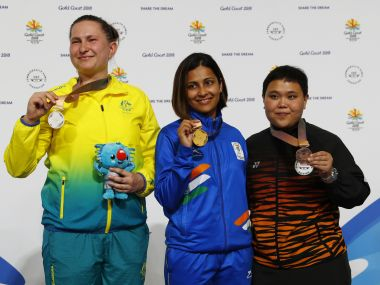 Gold medallist Heena Sidhu, silver medalist Elena Galiabovitch of Australia (L) and bronze medalist Alia Sazana Azahari of Malaysia on the podium after the 25m pistol event. Reuters