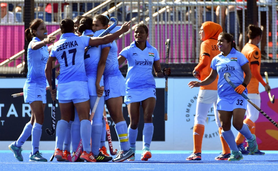 India's players celebrate after scoring a goal against Malaysia during their women's field hockey match at the 2018 Gold Coast Commonwealth Games. AFP