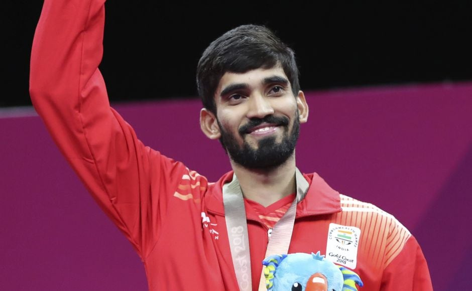 Silver medalist Srikanth Kidambi of India waves at supporters during the medal ceremony for men's singles badminton at Gold Coast. AP