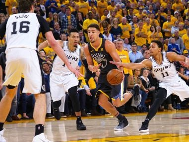 Klay Thompson drives between Spurs guards during game two of the first round of the 2018 NBA Playoffs. Reuters