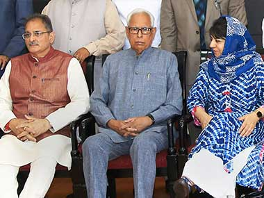 PDP. Jammu and Kashmir Governor NN Vohra, Chief Minister Mehbooba Mufti and Deputyy Chief Minister Kavinder Gupta at the swearing-in ceremony after the cabinet reshuffle, in Jammu. PTI
