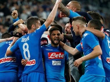 Napoli's Kalidou Koulibaly celebrates scoring their first goal with teammates. Reuters