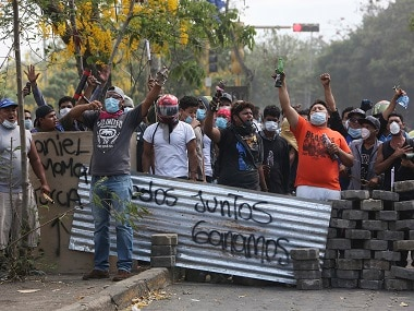 Protesters face off with security forces in Managua, Nicaragua. AP