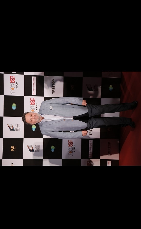 A suited up Rishi Kapoor looks at the cameras