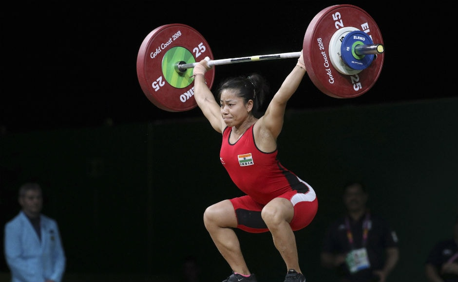 India's Sanjita Chanu competes in the women's 53Kg Weightlifting final during the Commonwealth Games,cin Gold Coast. AP