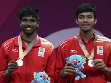 Silver medalists Satwik Rankireddy, left, and Chirag Shetty of India, stand on the podium during the medal ceremony for men's doubles badminton Gold Coast. AP