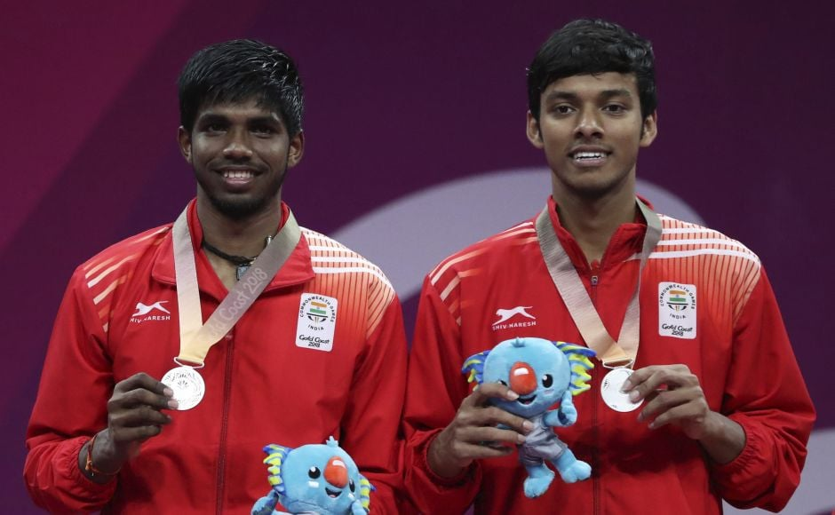 Silver medalists Satwik Rankireddy (L) and Chirag Chandrasekhar Shetty of India, stand on the podium during the medal ceremony for men's doubles badminton at Carrara Sports Hall during the Commonwealth Games on the Gold Coast. AP