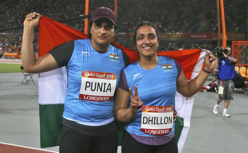 Silver medalist for the women's discus throw India's Seema Punia, left, and bronze medalist and compatriot Navjeet Dhillon celebrate with their national flag. AP