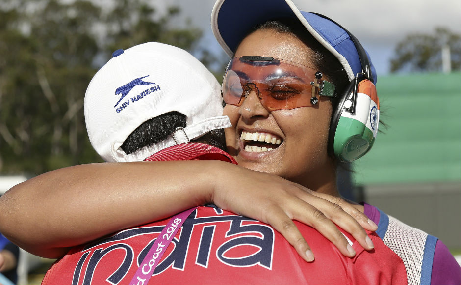 Shreyasi Singh of India, right, is hugged by her coach Mansher Singh after she won the gold medal. AP