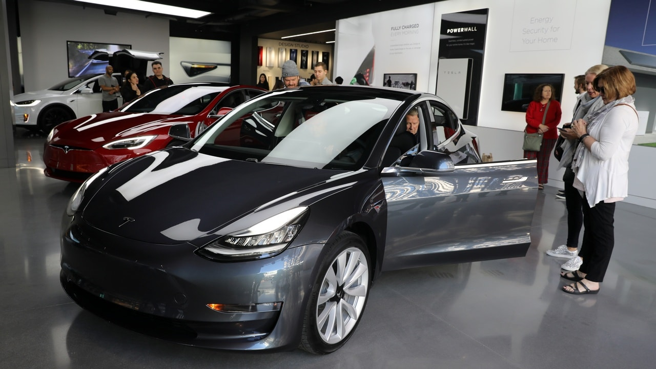 A Tesla Model 3 is seen in a showroom in Los Angeles, California. Image: Reuters