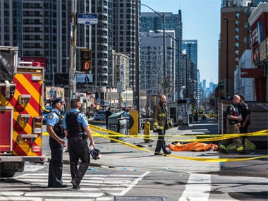 Van ploughs through crowded Toronto sidewalk killing 10 and injuring 15; driver arrested