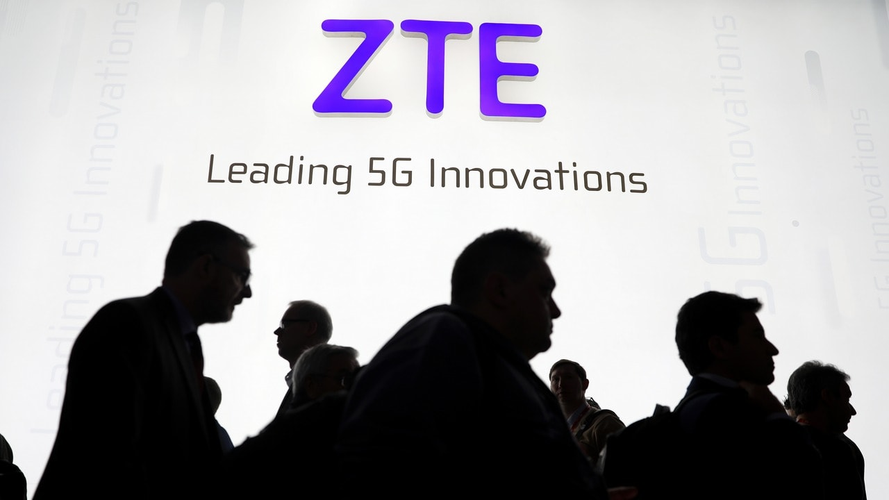 Visitors pass in front of the Chinese telecoms equipment group ZTE. Reuters