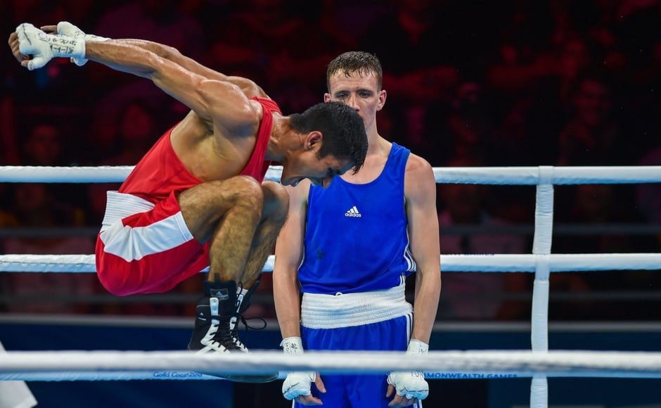India's Gaurav Solanki celebrates after winning gold in Men's Fly 52kg boxing finals at the Commonwealth Games 2018. He won a gold in his CWG debut PTI.