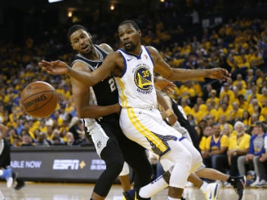 Golden State Warriors' Kevin Durant (R) vie for the ball with Spurs forward Rudy Gay in the first round of the 2018 NBA Playoffs. Reuters