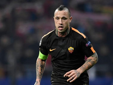 (FILES) In this file photo taken on November 22, 2017 Roma's Belgian midfielder Radja Nainggolan controls the ball during the UEFA Champions League group C football match between Atletico Madrid and AS Roma at the Wanda Metropolitan Stadium in Madrid. Belgium have left midfield creator Radja Nainggolan out of their World Cup squad, coach Roberto Martinez said on May 21, 2018. The absence of Nainggolan, who scored twice for Roma in the second league of the Champions League semi-final against Liverpool this month, was the biggest surprise in the 28-player list that will be reduced to 23 before the tournament. / AFP PHOTO / GABRIEL BOUYS