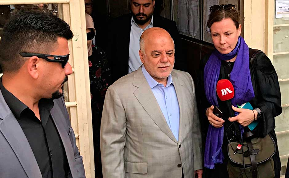 Abadi is considered by analysts to be marginally ahead, but victory is far from certain for the man who raised hopes that he could forge unity when he came to office. Iraq Prime Minister Haider al-Abadi, centre, leaves a polling station after casting his ballot. AP