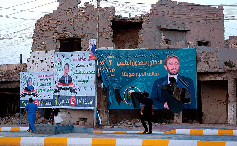 Even if Abadi's Victory Alliance list wins the most seats, he still has to negotiate a coalition government, which must be formed within 90 days of the election. Campaign posters for parliamentary elections are displayed near destroyed buildings from fighting between Iraqi forces and the Islamic State group in Ramadi. AP