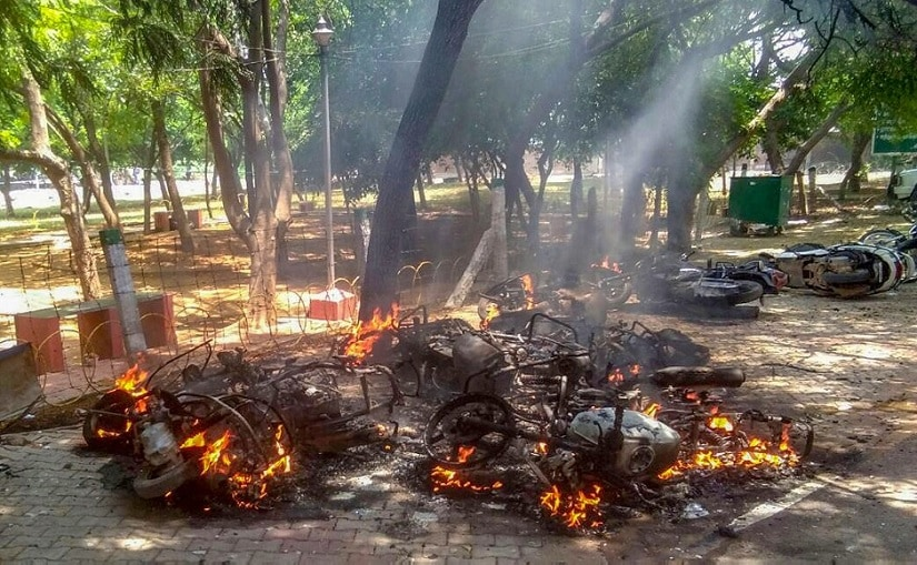 As the violent Anti- Sterlite protest entered the 100th day, vehicles were burned on the road. PTI
