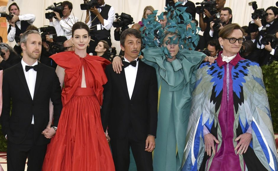 (From L-R) Adam Shulman, Anne Hathaway, Pierpaolo Piccioli, Frances McDormand and Hamish Bowles attend the Met Gala. Photo by Charles Sykes/Invision/AP
