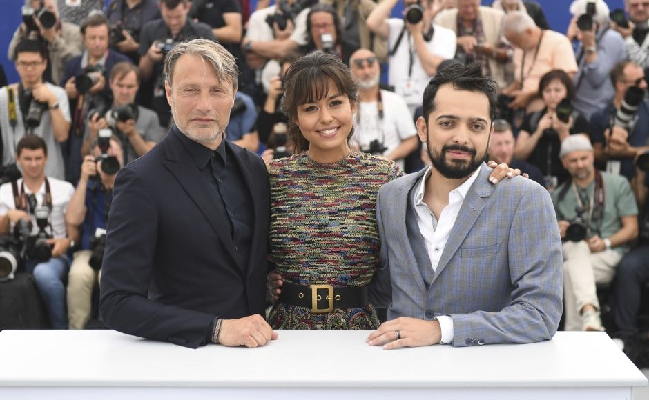 (From L-R) Actor Mads Mikkelsen, actress Maria Thelma Smaradottir and director Joe Penna pose for photographers during a photo call for the film Arctic. Photo by Arthur Mola/Invision/AP