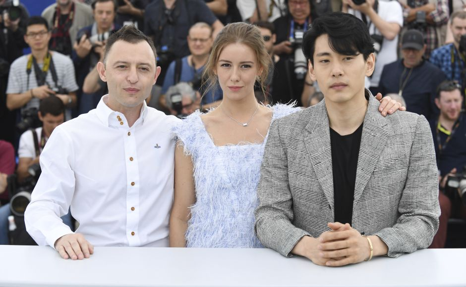 (From L-R) Actors Roma Zver, Irina Starshenbaum and Teo Yoo pose for photographers during a photo call for the film Leto at Cannes. Photo by Arthur Mola/Invision/AP