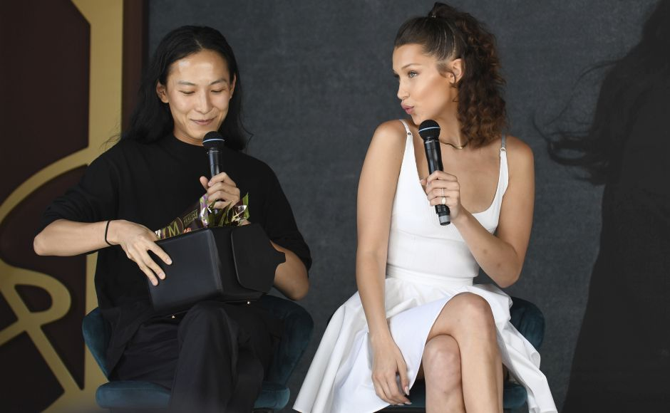 Designer Alexander Wang (L) and model Bella Hadid speak during a press conference for Magnum at the 71st international film festival, Cannes. Photo by Arthur Mola/Invision/AP