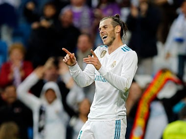 Real Madrid's Gareth Bale celebrates after scoring his side's 2nd goal during a Spanish La Liga soccer match between Real Madrid and Celta at the Santiago Bernabeu stadium in Madrid, Spain, Saturday, May 12, 2018. (AP Photo/Paul White)