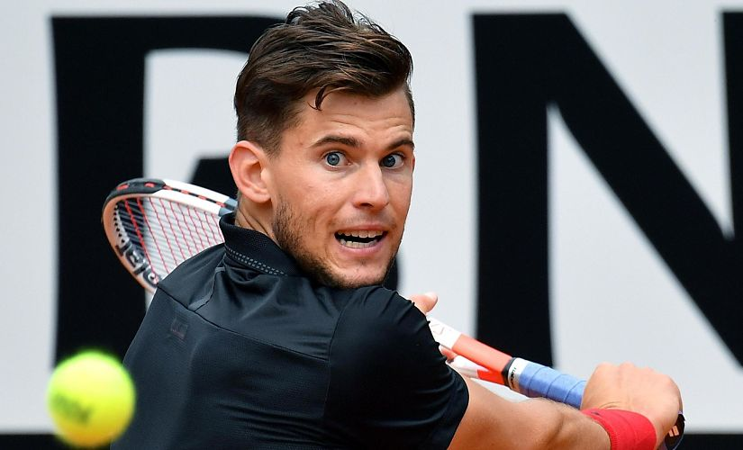 Austria's Dominic Thiem returns a backhand to Italy's Fabio Fognini during their Italian Open tennis tournament match, in Rome, Wednesday, May 16, 2018. (Ettore Ferrari/ANSA via AP)