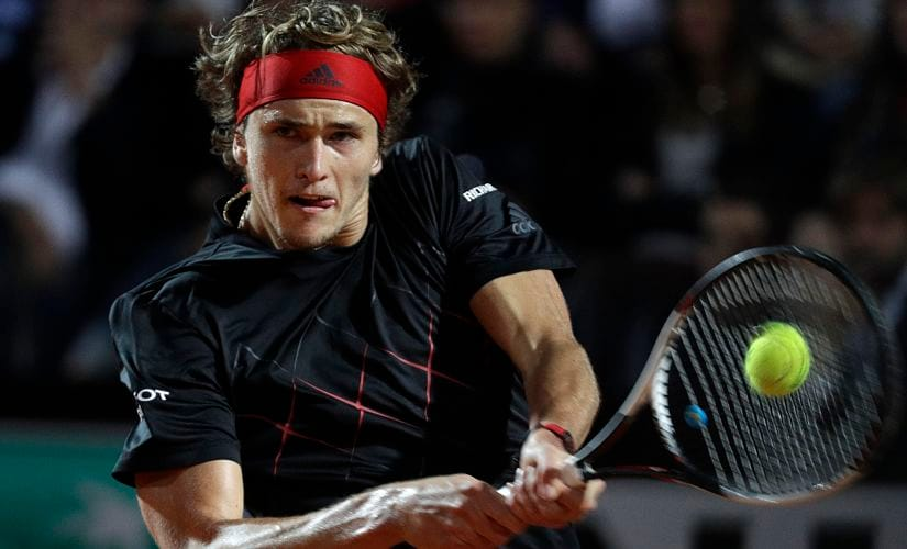 FILE - In this May 19, 2018, file photo, Germany's Alexander Zverev returns the ball to Croatia's Marin Cilic during their semifinal match at the Italian Open tennis tournament in Rome. Zverev will be competing in the French Open tennis tournament that begins on Sunday, May 27. (AP Photo/Gregorio Borgia, File)