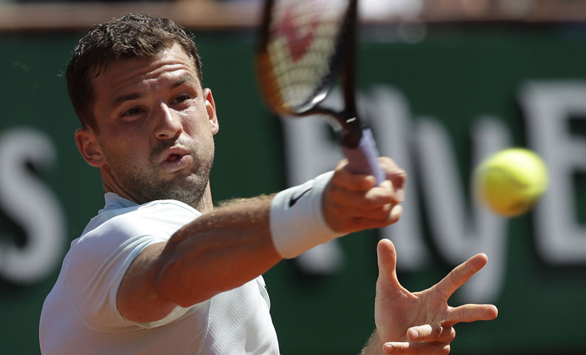 Bulgaria's Grigor Dimitrov returns the ball to Egypt's Mohamed Safwat during their first round match of the French Open tennis tournament at the Roland Garros Stadium, Sunday, May 27, 2018 in Paris. (AP Photo/Alessandra Tarantino)