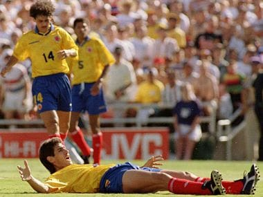 Colombian Andres Escobar Lays On The Pitch After Hitting The Ball Into His Own Net For