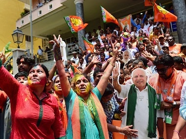 BJP workers celebrate party's lead on more than 110 Assembly seats. PTI