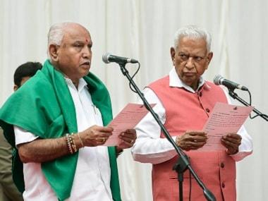 Governor Vajubhai Vala administers oath to BS Yeddyurappa. PTI