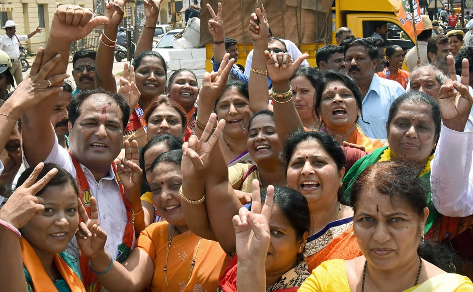 BJP workers celebrate the swearing-in of BS Yeddyurappa as the new chief minister of Karnataka, in Hubballi on Thursday. Loud chants of 'Modi, Modi' by around 100 jubilant cadres of the BJP were heard at the oath-taking ceremony at Raj Bhavan on Thursday. PTI