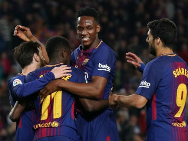 Barcelona's Ousmane Dembele celebrates with Lionel Messi, Yerry Mina and Luis Suarez after scoring their fifth goal. Reuters