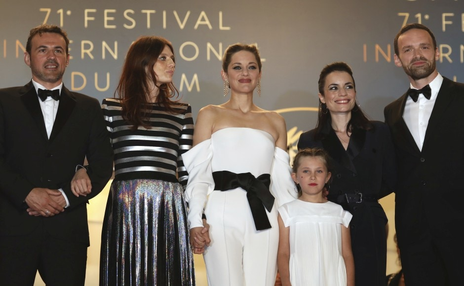 82 women walk the red carpet in Cannes film fest protest