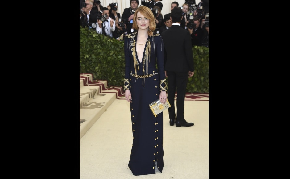 Emma Stone came to Met Gala with designer Nicolas Ghesquiere in a blue velvet dress.Photo by Evan Agostini/Invision/AP