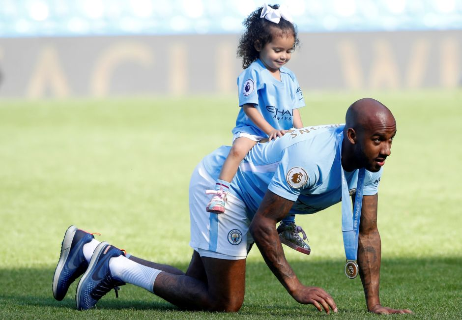Manchester City's Fabian Delph celebrates with his daughter after winning the Premier League title. Reuters